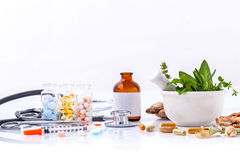 Herbal medicine VS Chemical medicine the alternative healthy . Royalty Free Stock Images