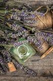 Herbal oil essence and lavender flowers. Vintage decoration. Ret Stock Image