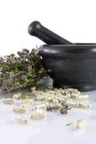 Herbal pills, dry thyme and mortar. Herbal pills, dry thyme and black ceramic mortar Royalty Free Stock Photos