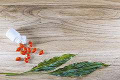Herbal pills and tablets on a wooden background Stock Photo