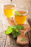 Herbal sage tea with green leaf in glass cup Royalty Free Stock Photos