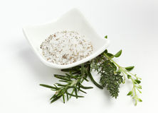 Herbal Salt. In a small bowl and twigs of Rosemary, Oregano and Thyme Royalty Free Stock Photography