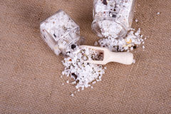 Herbal salt in containers Stock Photography