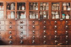 Herbal shop or Chinese herb store dried wooden antique cupboard stock photo