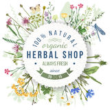 Herbal shop round emblem with herbs and flowers. Herbal shop round emblem over wild herbs and flowers pattern. Easy to use in your organic and eco friendly Stock Photos