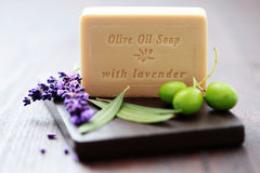 Herbal soap. Bar of herbal soap with fresh herbs and olives - beauty treatment Stock Image