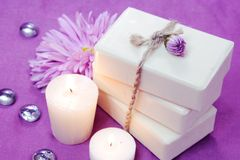 Herbal Soap with Candles and Flowers. Stack of Herbal Soap with Candles and Flowers Stock Images