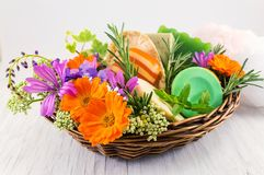 Herbal soaps and fresh spring flowers Royalty Free Stock Photo