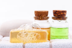 Herbal spa soap bar on white bath towel with honey isolate . Stock Images