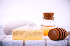 Herbal spa soap bar on white bath towel with honey isolate on wh Stock Photos