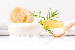 Herbal spa soap bar on white bath towel with thyme,rosemary . Stock Photo