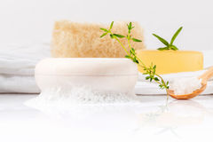Herbal spa soap bar on white bath towel with thyme,rosemary. Royalty Free Stock Images