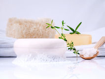 Herbal spa soap bar on white bath towel with thyme,rosemary and Royalty Free Stock Photography