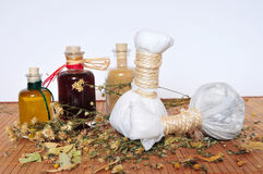 Herbal stamps massage oil. Oil herbs stamps massage Wellness Royalty Free Stock Images