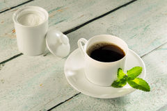 Herbal sweetener stevia. In powder form and a cup of coffee Royalty Free Stock Images