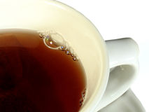 Herbal tea. Cup of herbal tea with bubbles and tea bag stock image