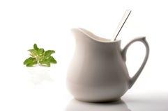Herbal tea. Pot on white Royalty Free Stock Image