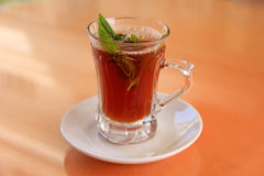 Herbal tea. With green leaf Stock Photo