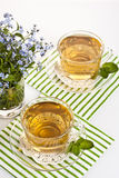 Herbal tea. Two cup of fresh herbal tea in the background Royalty Free Stock Photo