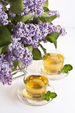 Herbal tea. Cup of fresh herbal tea with lilac Stock Photo