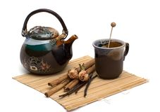 Herbal tea. Still-life about herbal tea with a vanilla, a rose, a cinnamon. Isolated on white Stock Photography