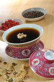 Herbal Tea. Chinese traditional herbal tea and herbs Stock Photo