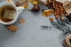 Herbal tea, almonds, grapes, honey, figs, dry leaves, lavender o Stock Images