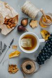 Herbal tea, almonds, grapes, honey, figs, dry leaves, lavender o Royalty Free Stock Image
