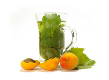 Herbal Tea And Ripe Apricots Stock Photography