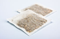 Herbal tea bags laying on table Stock Photos