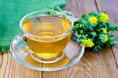 Herbal tea with a bouquet of Rhodiola rosea on the board Stock Image
