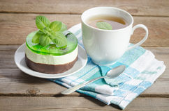 Herbal tea with cake on wooden background Stock Photos