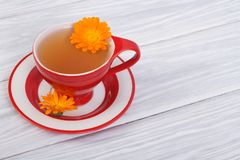 Herbal tea with calendula flowers Royalty Free Stock Photos