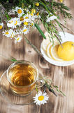 Herbal tea with camomile and lemons Stock Images
