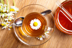 Herbal tea of chamomile, with blossoms, honey, on rustic wooden flooring Stock Image