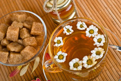 Herbal tea with chamomile and cane sugar Stock Images