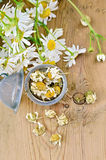Herbal tea from chamomile dry in a strainer Stock Photos