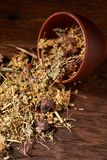 herbal tea in clay bowl on wooden table on black background. selective focus stock images