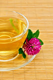Herbal tea with clover on a bamboo mat Royalty Free Stock Images