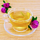 Herbal tea with clover on bamboo napkin Royalty Free Stock Images