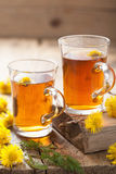 Herbal tea with coltsfoot flowers Stock Image