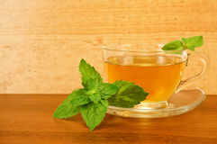 Herbal tea in cup with mint on a wooden board Royalty Free Stock Images