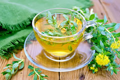 Herbal tea in cup with Rhodiola rosea and napkin Royalty Free Stock Images