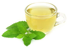 Herbal tea in a cup with tulsi leaves Royalty Free Stock Photo