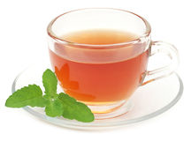 Herbal tea in a cup with tulsi leaves. Over white background Stock Photo