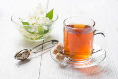 Herbal tea in a cup on a white surface Stock Photography