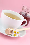 Herbal tea with daisies and honey Royalty Free Stock Photos