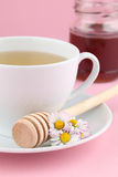 Herbal tea with daisies and honey Royalty Free Stock Image