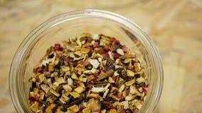 Herbal tea dried blend of rose glass jar cup, apple, lemon peel, cranberry, orange peel, star anise winter punch, cloves