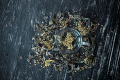 Herbal tea on ebony Royalty Free Stock Photography